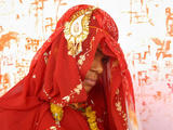 Fifteen-Year-Old Girl Poses for a Photograph after Her Marriage