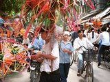 Vietnamese Vendors Crowd a Street Selling Colored Lanterns on a Street in Downtown Hanoi