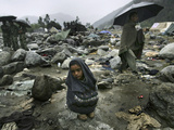 A Pakistani Earthquake Survivor Shivers