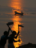Indian Laborers Work on the Banks of the River Ganges at Sunset