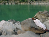 A Hindu Pilgrim Rests Along the Peaceful Bank of the Ganges River Near Rishikesh