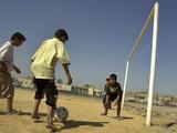 Iraqi Boys Play Soccer in a Baghdad Neighborhood