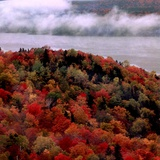 Mist Lingers Over Lobster Lake as Trees Show off Their Splendid Colors During Peak Fall Foliage