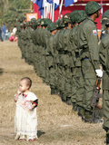 A Young Karen Child Seems Lost in a Karen Army Formation