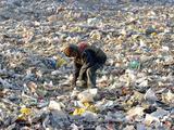 An Impoverished Mongolian Man Sorts Through Garbage at an Ulan Bator Dump