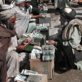 Afghan Money Changers on the Roadside Market