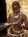 Turkana Woman Weaving near Straw Hut  Lake Turkanam  Kenya