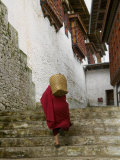 Monk Carrying Basket in Trongsa Dzong  Bhutan