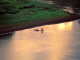 Sunset on Karo Men in a Dugout Raft  Omo River  Ethiopia