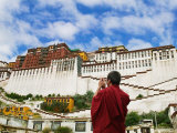 Tibetan Monk with Potala Palace  Lhasa  Tibet  China