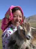 Tibetan Girl Holding Sheep in the Meadow  East Himalayas  Tibet  China