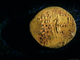 Gold Coin with Enthroned Archer and Greek Inscription  Six Tombs of Bactrian Nomads