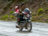 Tibetan Family Traveling on Motorbike in the Mountains  East Himalayas  Tibet  China