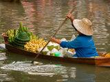 Old Woman Paddling Boat at Floating Market  Damoen Saduak  Thailand
