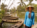 Woman Near Old Boats  Mekong Delta  Vietnam