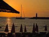 Sunset on Sailboat  Lighthouse and Umbrellas  Kusadasi  Turkey