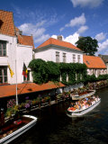 Houses and Boats with Tourists  Canals of Bruges  Belgium