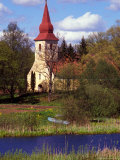 Church Nestled in Rural Landscape with Boat and Pond  Latvia