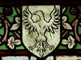 Close-up of a Bird Image on an Illuminated Stained Glass Window