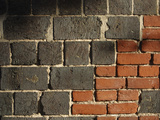 Close-up of a Gray and Red Brick Wall