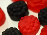 Close-up of Red and Black Chewy Candy Pieces