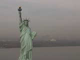 The Statue of Liberty Against a Cityscape in Smog