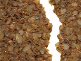 Close-up of a Rough Broken Granola Bar with Chunks of Grains