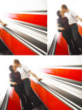 Snapshots of Man and Woman Kissing on Bright Colorful Escalator