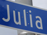 A Blue Street Name Sign with White Lettering