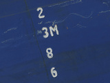 A Blue Metal Background with White Numbers in a Line
