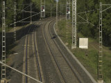 Two Sets of Railroad Tracks with Signal Lights on Poles