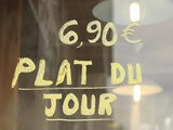 A Cafe Window with French Words and Numbers