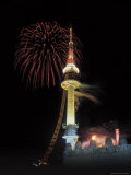 Illuminated Tower and Buildings with Colorful Fireworks