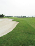 A Landscaped Golf Course with Sand Trap