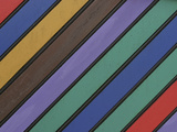 Colorful Stripes Painted on Wooden Slats in a Diagonal Pattern