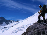 A Mountain Climber Stands on Emmons Glacier in the Mt Rainier National Park  Washington  USA