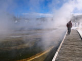 People Walking Boardwalk Over Hot Springs of Black Sand Basin  Yellowstone Nat Park  Wyoming  USA