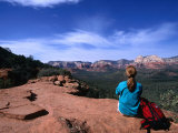 A Hiker Taking in the Views of Red Rock Wilderness in Sedona  Sedona  Arizona  USA