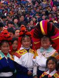 Miao Flower Girls in Traditional Costume Standing in Crowd  Nankai  China