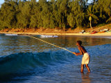 Boy Fishing off Beach  Tofo  Mozambique