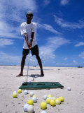 Bahamian Golfer Tees Up on the Pink Sand  Pink Sands Beach  Harbour Island  Bahamas