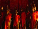 Saffron Draped Buddhas in Wat Xieng Thong  Luang Prabang  Laos