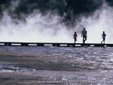 Tourists Silhouetted Against Steam from Grand Prismatic Spring  Yellowstone National Park  USA
