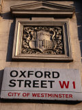 Coat of Arms and Street Sign on Wall  Oxford St  London  United Kingdom