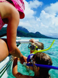 Children Snorkelling from Motor Boat  French Polynesia