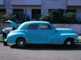 Man Looking in Boot of a Blue 1948 Chevrolet  Vedado  Cuba