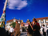 Tibetans Walking Around Jokhang Temple Spinning Prayer Wheels in Barkhor Square  Lhasa  China