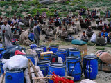 Porters Waiting for Loads to Be Distributed in Hindu Kush Range  Pakistan
