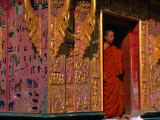 Buddhist Monk Standing in Doorway of Wat Xieng Thong  Luang Prabang  Laos