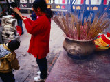 Woman Burning Incense at Wong Tai Sin Temple  Kowloon  Hong Kong  China